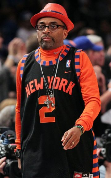 Spike in a Knicks orange fedora, matching turtleneck and #2 jersey for game three of the Eastern Conference Quarter finals in the NBA Playoffs