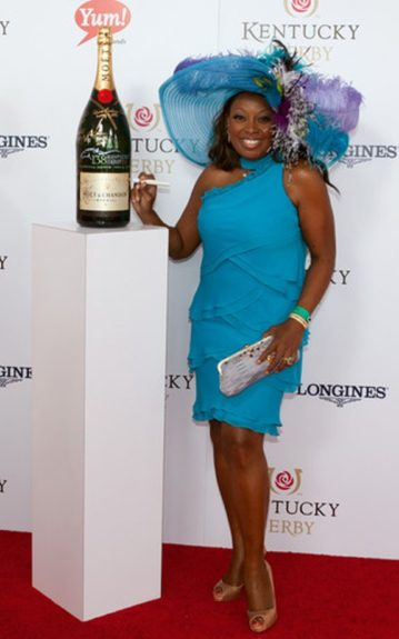 Star Jones wore an electric blue four-tiered dress with a matching hat dramatically embellished with flowers and feathers