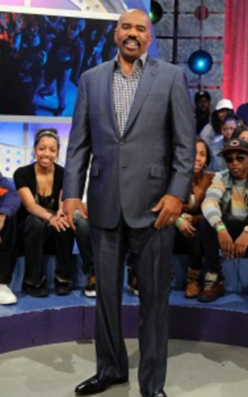 Steve Harvey kept it clean and tailored in blue suit with a checkered collared shirt underneath.