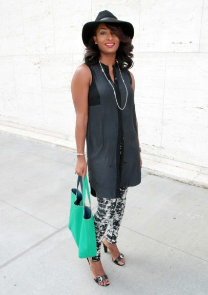 The fabulous Toccara Jones sported a long button up tank with marble pants and a spring green bag.