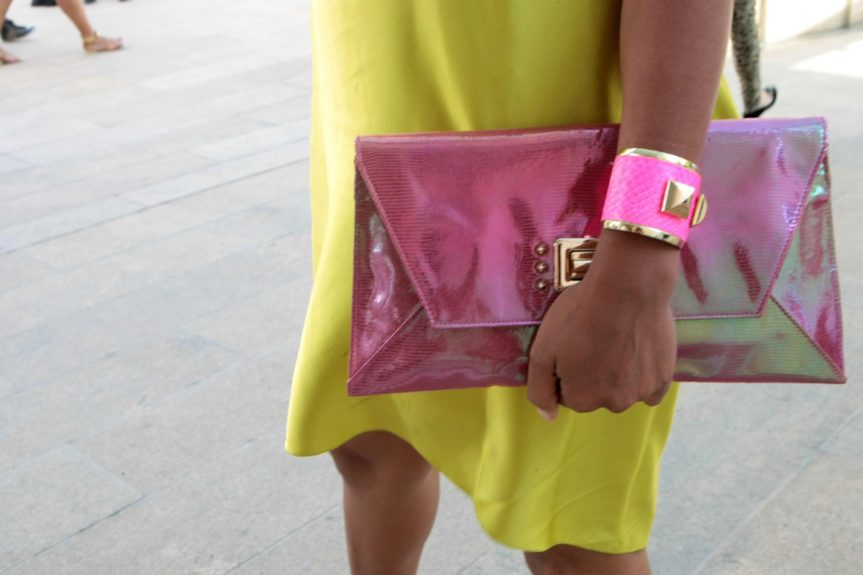 A fun touch with a neon pink bangle and glossy clutch  makes the dress pop the most.