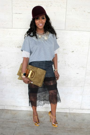 June Ambrose gives it all in a lace-over mini jean skirt and embellished sweater.