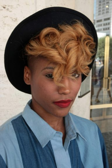 See what we mean. And she added the rich red lip and hipster touch to her hat and blonde hair combo.