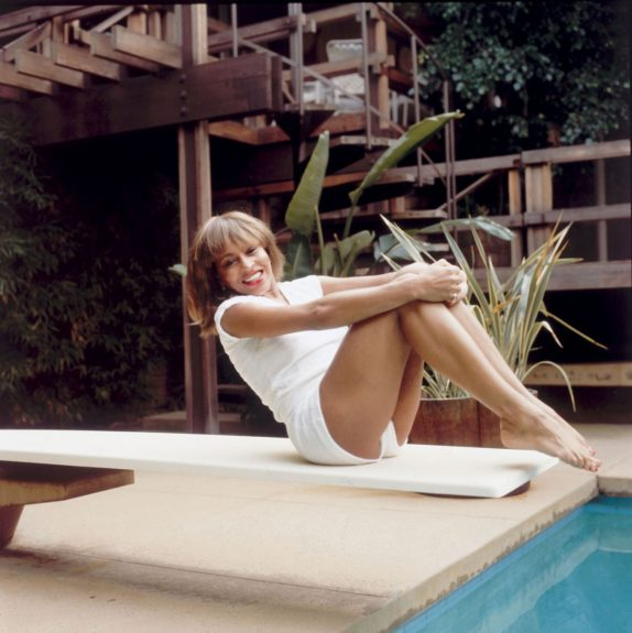 Tina Turner posed outside on a diving board; 1982. (Issac Sutton/EBONY Collection)
