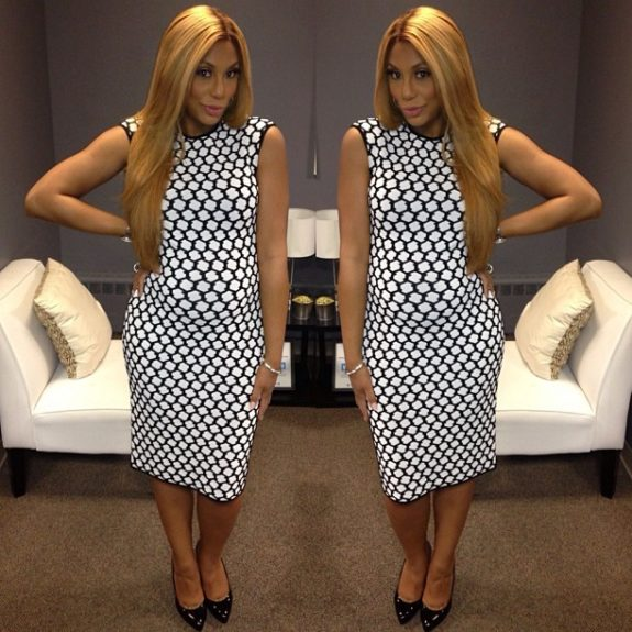 """""""So nice you got to have it twice""""! Tamar must really find the honeycomb print irresistible. She did that in this Alexander Mcqueen bodyconprinted dress in black and white, with bone straight tresses and black pointy toe heels."""