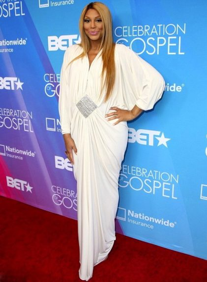 Contoured to perfection! Tamar's flawless makeup and soft pink lip was a perfect accompaniment to the white of her Marc Bouwer gown and embellished stone center at the 2013 BET Gospel Awards.
