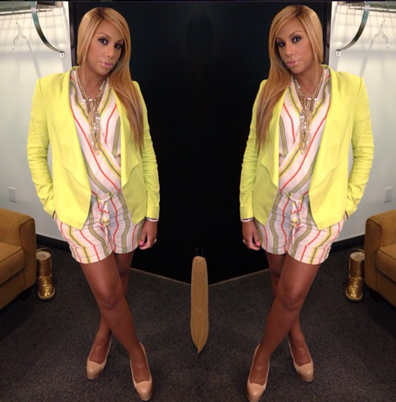 Girls just want to have fun! We dig the playful stripes on Braxton's BCBG Maxazaria romper underneath her neon blazer by the brand, accented by nude YSL pumps.