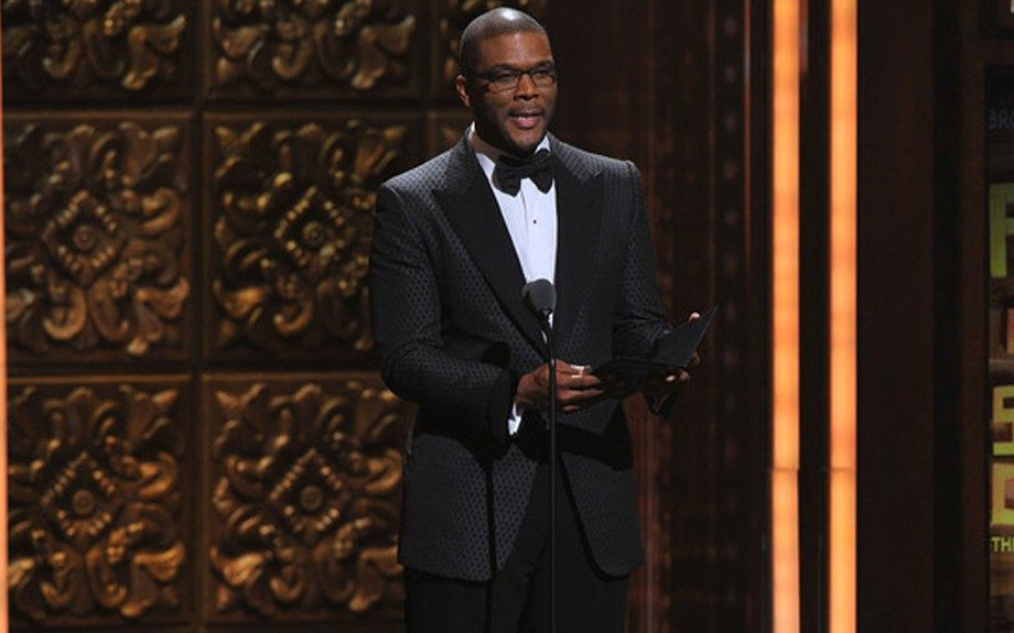 Tyler Perry looks very elegant presenting a Tony award, in his printed black tuxedo, and crisp white button down