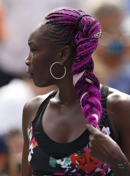 Monday, Venus hit the courts with her signature colored braids to start the U.S. Open Tournament.