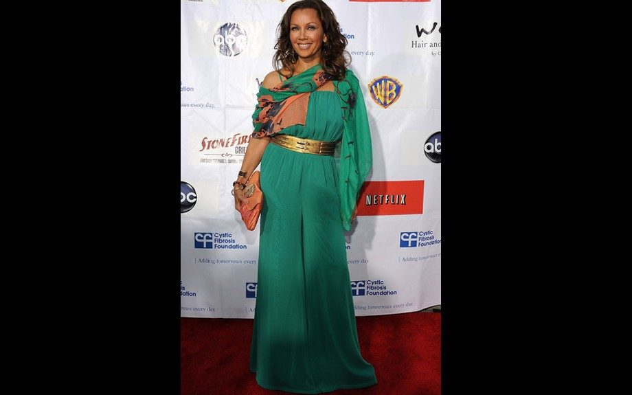 Vanessa Williams graced the red carpet for the 2nd Annual Wysteria Lane Block Party in a green jumpsuit carrying an orange oversized clutch.