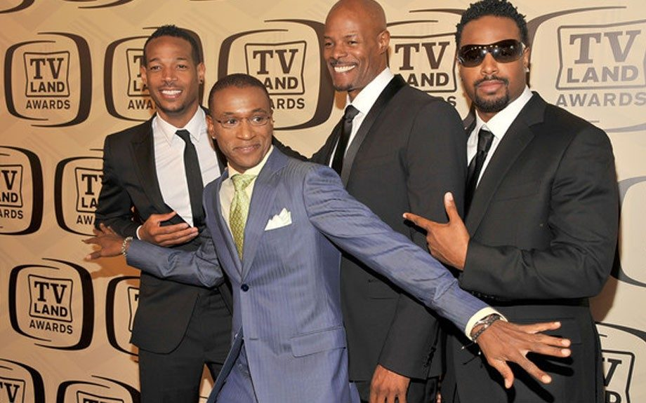 "Marlon, Keenan and Shawn Wayans go for a ""Men in Black"" look in black suits, crisp white shirts, black ties and of course those ultra dark shades on Shawn. Tommy Davidson adds some color with a blue striped suit accessorized with a gold tie and handkerchief"
