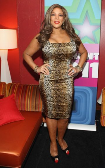 Real or not, Wendy Williams' bust size is unashamedly large yet she still isn't afraid to reach for the prints and low cuts like this leopard print, bodycon, square neck dress. The lighter and dark leopard contrast slim her figure significantly