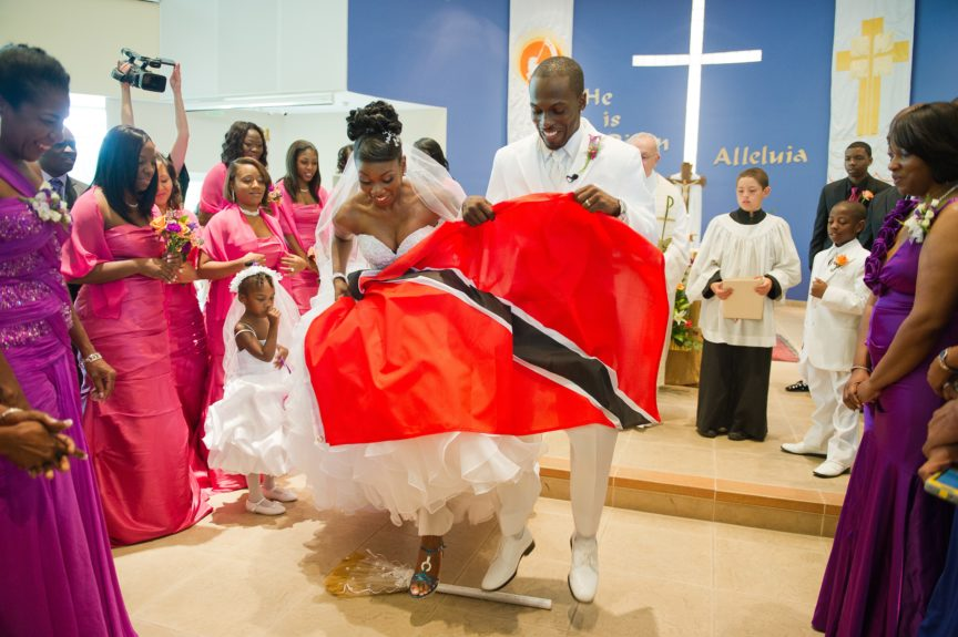 Jumping the Broom: The couple ends their ceremony with an African tradition