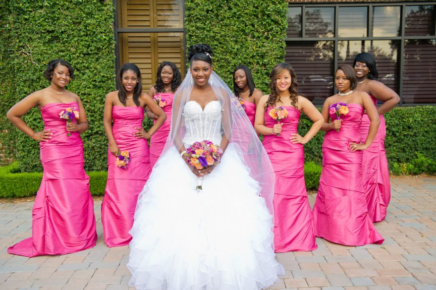 The Bridal Party: Whyte's bridesmaids looked stunning in rich pink, floor length gowns