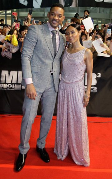 Jada Pinkett-Smith stood by her man for the Men in Black 3 Seoul, Korea premiere matching the lavender shirt under his plaid suit with her lavender, sequined Giorgio Armani jumpsuit