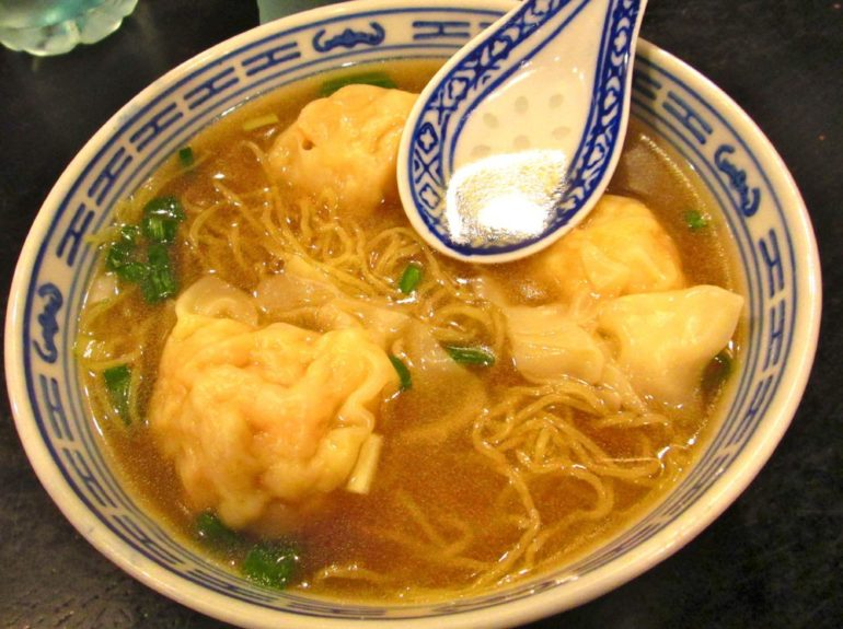 Wonton soup. Hong Kong-style wontons are filled with shrimp.