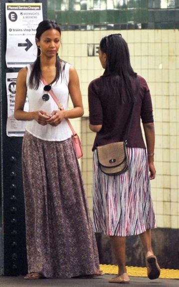 The two were spotted boarding a train at West 4th Street in flowy skirts, flats and cross body bags