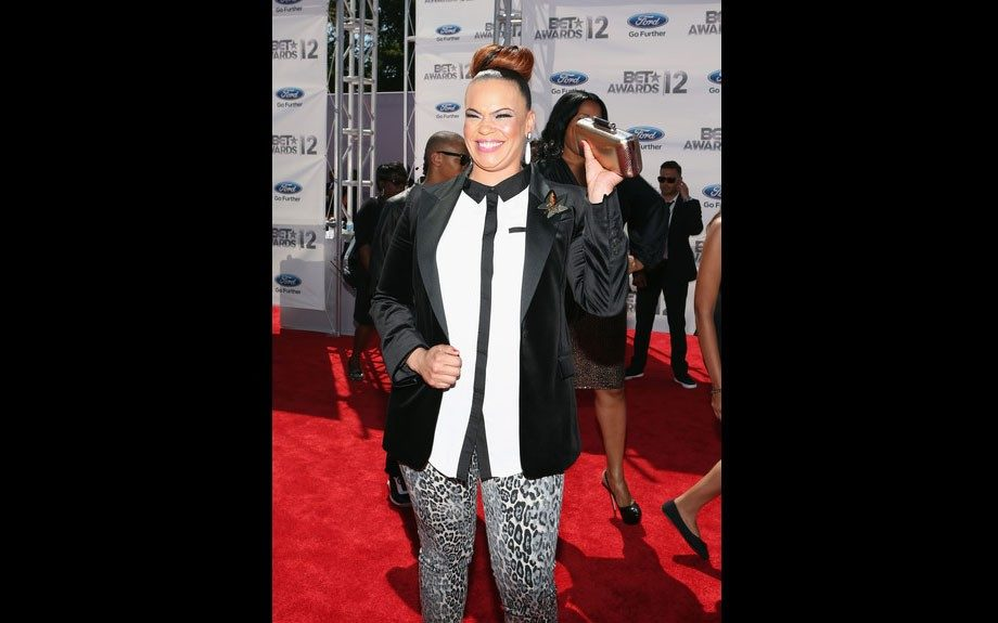 Faith is delighted to pose in her white and black blouse, black blazer, and cheetah print leggings.