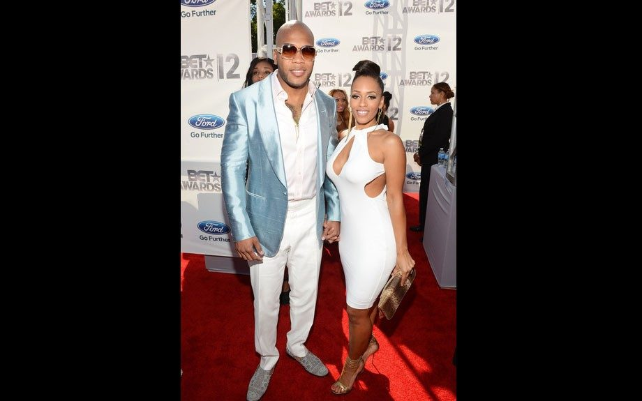 FloRida brings his boo Melyssa Ford as his date. He's in a shiny light blue blazer, and white pants and shirt. She matches him in a white dress with cutouts.