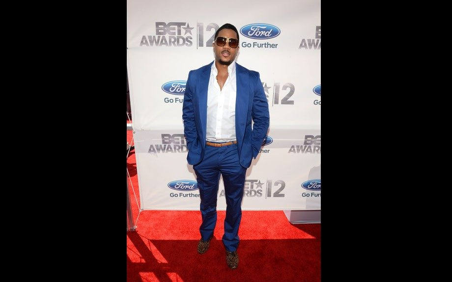 """""""The Game"""" star Hosea Chancez looks stylish in his modern royal blue suit, crisp white shirt, and leopard loafers."""