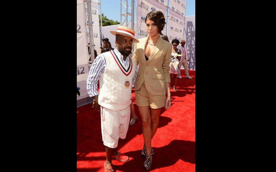 JD looks very classy in his striped blue and white shirt, off white sweater vest, and off white shorts. His date looks pretty in her gold matching blazer and shorts, and printed pumps.