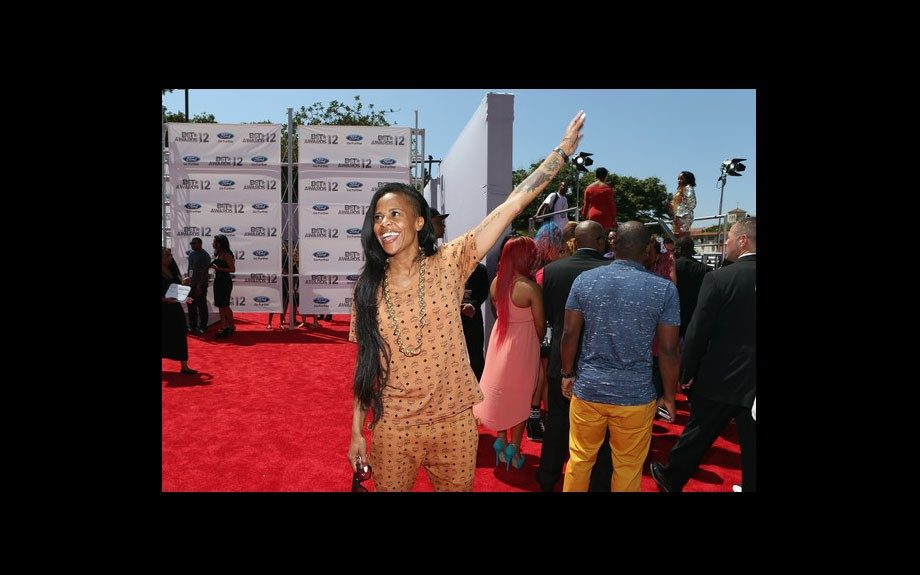 Laurieann Gibson looks like she's about to break into one of her famous dance moves. She wears a printed MCM matching shirt and pants set.