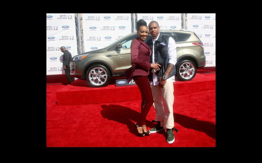 Monica and her hubby Shannon Brown enjoy their time on the red carpet. She wears a burgundy suit, he wears a denim vest, white button down, khaki pants, and green shoes.
