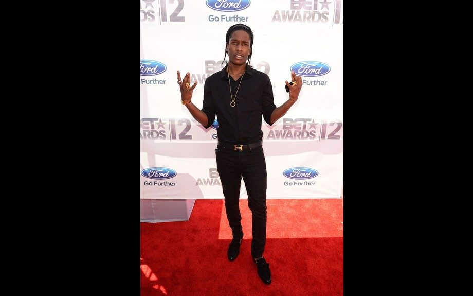 A$AP Rocky poses in an all black outfit on the red carpet.