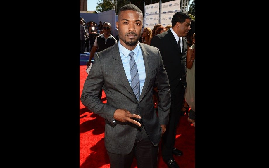 Ray J looks handsome charcoal gray suit, blue button down shirt, and blue and gray tie…we wonder if he and Kim exchanged hellos?
