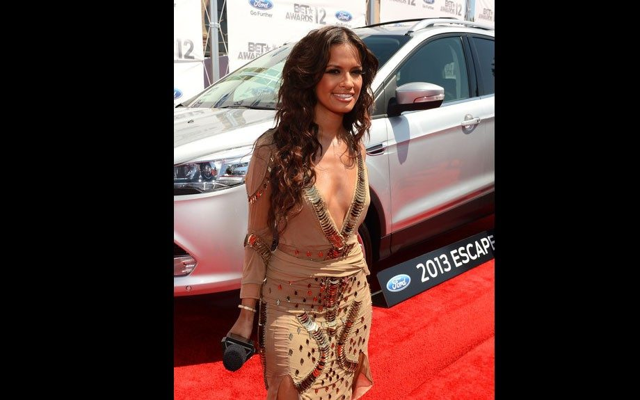 Rocsi goes for a sexy look in a tan, low cut embellished dress with thigh high slits.