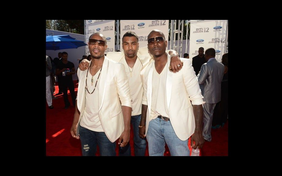 Tank, Ginuwine, and Tyrese pose for a picture…as a group. The new TGT all wore matching looks of cream blazers, v necks, and jeans.