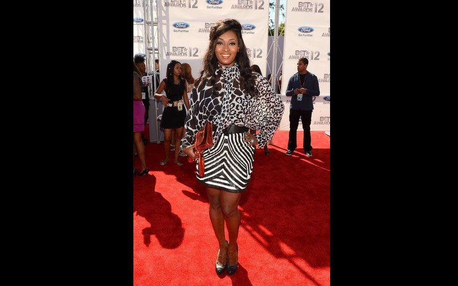 Toccara is the queen of the jungle in a 3 animal print dress(giraffe, cheetah, zebra), and black pumps.