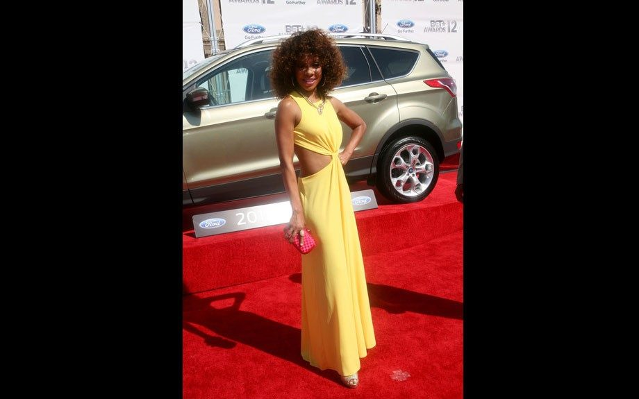 Wendy Raquel Robinson shows off her slim figure in a beautiful yellow gown, with a back cut out.