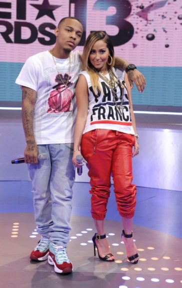 Adrienne Bailon got some good publicity co-hosting <em>106 & Park</em> in a Le Shirt Paris France Muscle Tee, PRSVR red leather sweatpants, and a pair of Givenchy sandals. Photo Credit: WENN