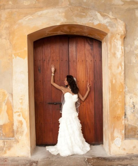 The bride Lachelle Robinson wears a halter corseted gown flowing into whimsical ruffles