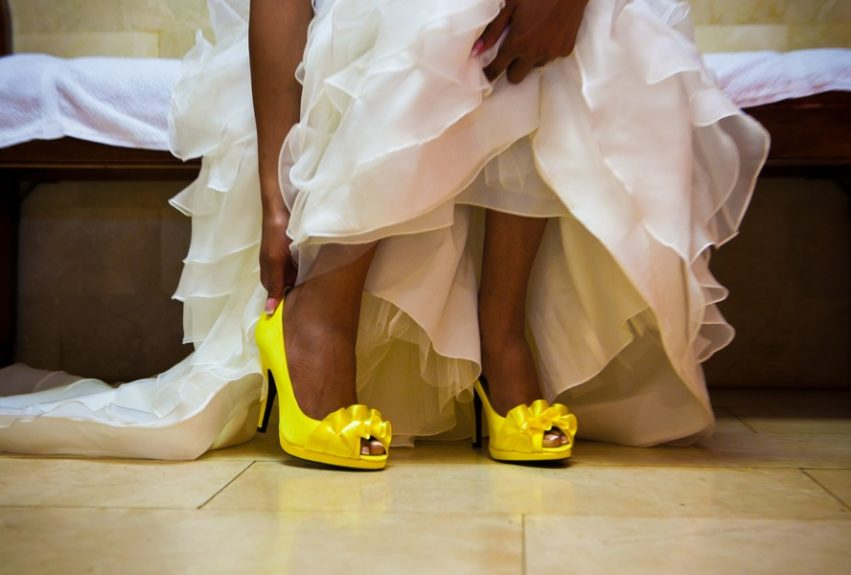 The bride Lachelle Robinson pairs her traditional white gown with a burst of color in these peep-toe yellow heels