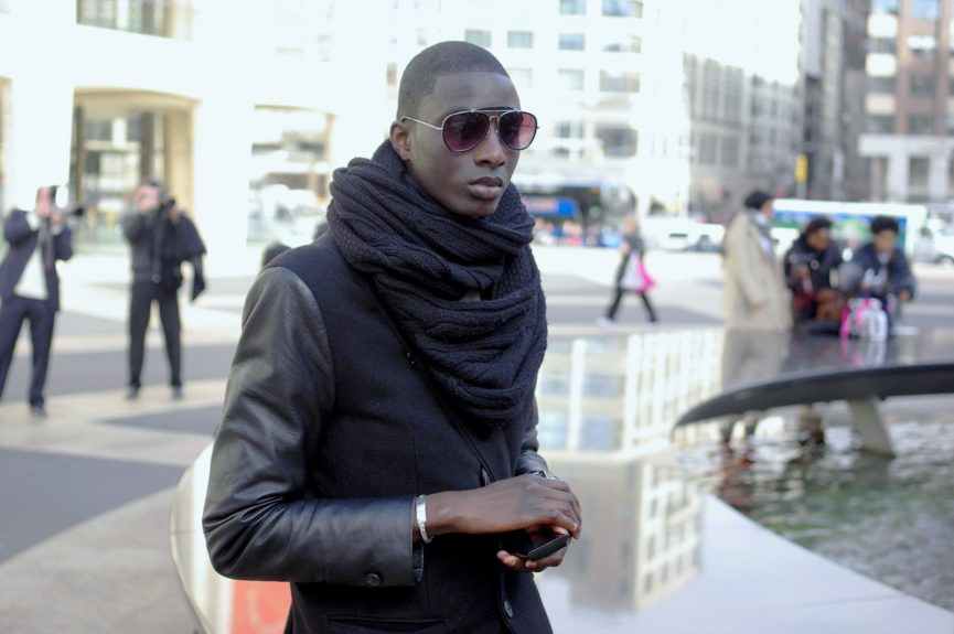 Aly Ndiaye (student) wearing a H&M jacket and shoes, liquid diesel pants, and an INC scarf.