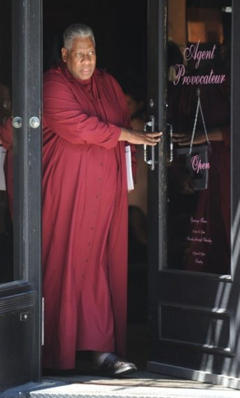 André Leon Talley is always draped in cloths, and he rocks a wine colored frock as he exits a woman's lingerie store… hmmm. Photo Credit: Splash
