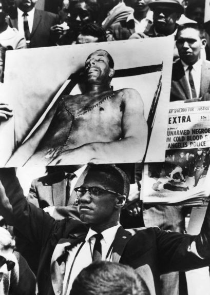 Activist Malcolm X is photographed protesting the death of a Muslim man killed by L.A. police. (Moneta Sleet, Jr./EBONY Collection)