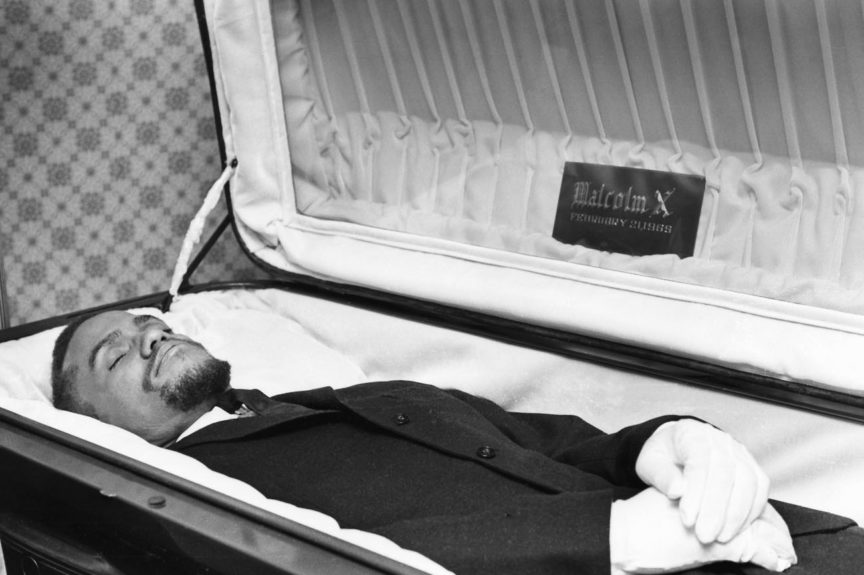 Photograph of Malcolm X in casket. (Moneta Sleet, Jr./EBONY Collection)