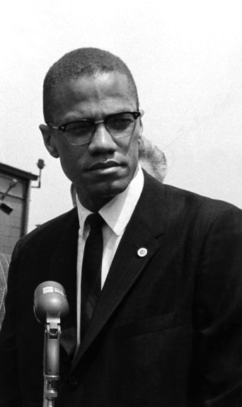 Malcolm X photographed before giving a speech. (Maurice Sorrell/EBONY Collection)