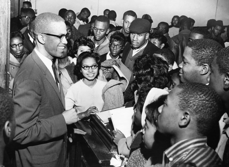 Malcolm X draws the attention of Atlanta college students. (Harmon Perry/EBONY Collection)