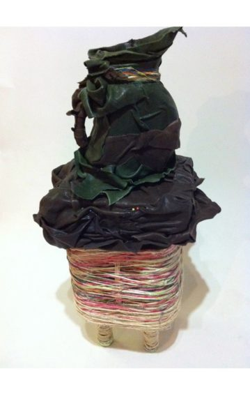 Dianne Smith, Spirit Juice, 2012. Wine bottles, leather, rope, string, pushpins, Variable.