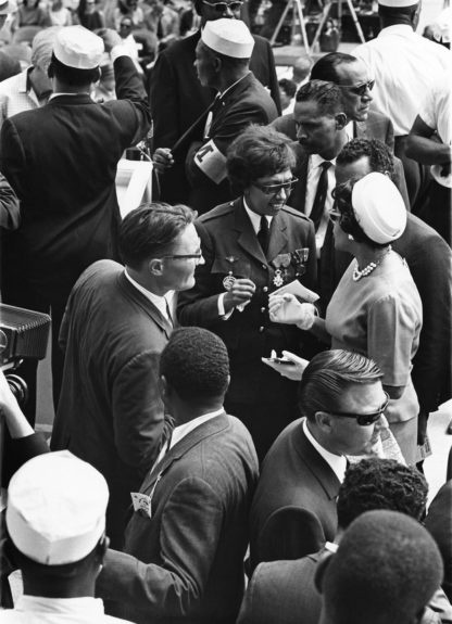 Josephine Baker, a keynote speaker, is photographed talking to other march attendees.  (Norman L. Hunter/EBONY Collection)