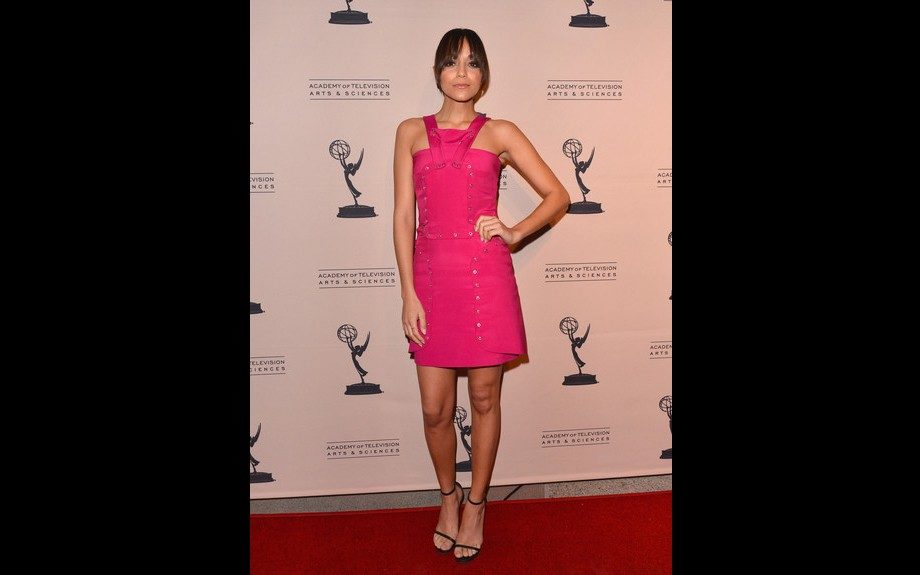 Ashley Madekwe hung out on the red carpet in North Hollywood in a Versace Pink Grommet dress and a pair of Saint Laurent Classic Jane sandals, she often gives us girly. Photo Credit: WENN