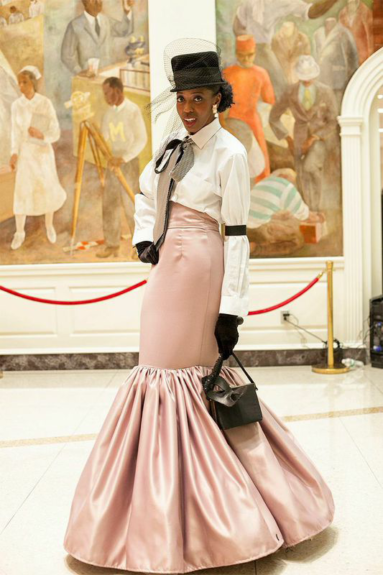 A guest brings old-school Harlem glamour to the ball.  Photography by Adama Delphine Fawundu