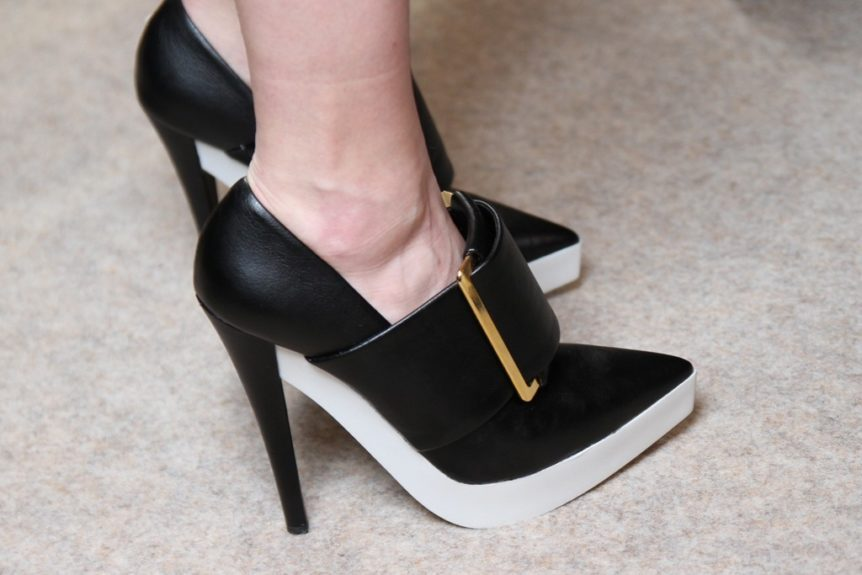 The buckled version of Alicia Key's sleek shoe, McCartney's pointy-toe black and white buckle pumps