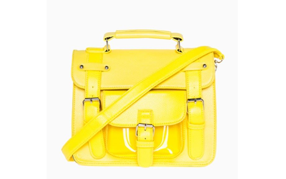 """A neon bag is Summer's go-to, and will pop against Fall hues. This Neon Three Strap Satchel is perfect for weekend and night events, $39.99, <a href=""""http://goo.gl/j0pWav"""" target=""""_blank"""">www.dailylook.com</a>."""