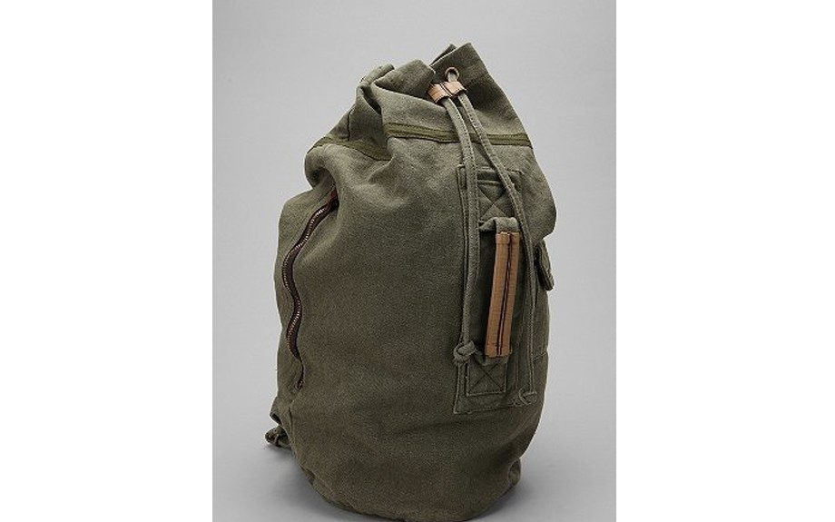 """<a href=""""http://www.express.com/clothing/camouflage+canvas+tote/pro/4720082/cat400001"""" target=""""_blank"""">Camouflage Canvas Tote</a>($128,<a href=""""http://express.com/"""">express.com</a>)"""