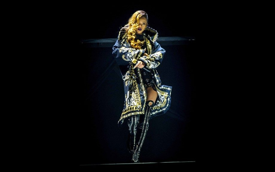 One of Rihanna's costumes for her Diamonds tour includes this custom made Givenchy parka. Those thigh-high boots slay. Photo: INF
